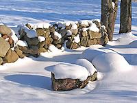 Snowy Stone Fence in Winter
