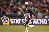 New York Red Bulls defender Rafael Marquez (4) beats LA Galaxy forward Juan Pablo Angel (9) to the ball. The LA Galaxy and Red Bulls of New York played to a 1-1 tie at Home Depot Center stadium in Carson, California on  May 7, 2011....