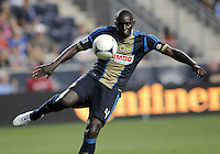 CHESTER, PA - AUGUST 12, 2012:  Bakary Soumare  (4) of the Philadelphia Union clears the ball against the Chicago Fire during an MLS match at PPL Park, in Chester, PA on August 12. Fire won 3-1.
