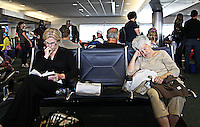 Passengers wait for a delayed flight at Fort Lauderdale Hollywood International Airport.
