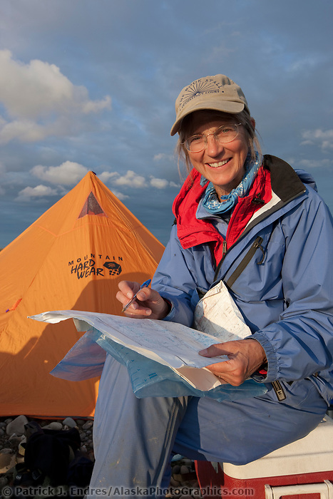 Alaskan author Debbie Miller at camp along the Etivluk river in Alaska's midnight sun, National Petroleum Reserve, Alaska.