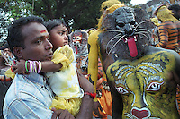 Pulikali performance at Swaraj road, Trichur, Kerala, India..Pulikali or Kaduvvakali is a two hundred year old folk dance form, practised mostly in Thrissur and Palghat districts of Kerala. It liberally makes use of forms and symbols of nature that finds expression in its bright, bold body painting and high-energy dance movements. The philosophy of Pulikali is that human and nature are integral parts of each other. So by fusing man and beast in its artistic language, it flamboyantly celebrates the connection. Arindam Mukherjee