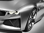 Closeup of BMW Vision ConnectedDrive concept sports car headlight and shiny body detail