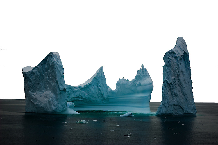 """This iceberg reminds of the painting by Bocklin called """"The Isle of the Dead"""" - it's difficult to show scale with an image like this, but the iceberg was at least 100m tall in places, if not more. Photographed from on board the Greenpeace ship Esperanza, in the Southern Ocean, 8th February 2007. ...."""