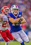 9 November 2014: Buffalo Bills wide receiver Chris Hogan guards the ball as he scores a first quarter touchdown on a 25-yard pass-rush play against the Kansas City Chiefs at Ralph Wilson Stadium in Orchard Park, NY. The Chiefs rallied with two fourth quarter touchdowns to defeat the Bills 17-13. Mandatory Credit: Ed Wolfstein Photo *** RAW (NEF) Image File Available ***