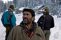 A local Kashmiri man looks up towards Mt Arpharwat (4124m). Locals to the area are hoping that the opening of the Gulmarg Gondola will bring many tourists back to Gulmarg. Financially Kashmir has suffered hugely since tourists stopped coming to kashmir in 1989 when fighting broke out between kashmiri seperatists and the Indian army.