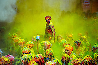 A man standing amidst the cloud of yellow color...<br />