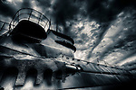 German U-boat under clouds that resemble waves at sea.