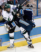 Jeff Dunne (Michigan State - Grover, MO), Rob Bellamy (University of Maine - Westfield, MA) - The Michigan State Spartans defeated the University of Maine Black Bears 4-2 in their 2007 Frozen Four semi-final on Thursday, April 5, 2007, at the Scottrade Center in St. Louis, Missouri.