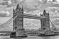 A black and white view of Tower Bridge in London spanning the River Thames.