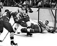 Seals vs NorthStars 1970: Seals Gary Jarrett and Gerry Ehman, Stars Tom Reid, and goalie Gump Worsley. (photo/Ron Riesterer).