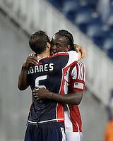 Chivas USA midfielder Shalrie Joseph (18) hugs former teammate New England Revolution defender AJ Soares (5). In a Major League Soccer (MLS) match, the New England Revolution tied Chivas USA, 3-3, at Gillette Stadium on August 29, 2012.