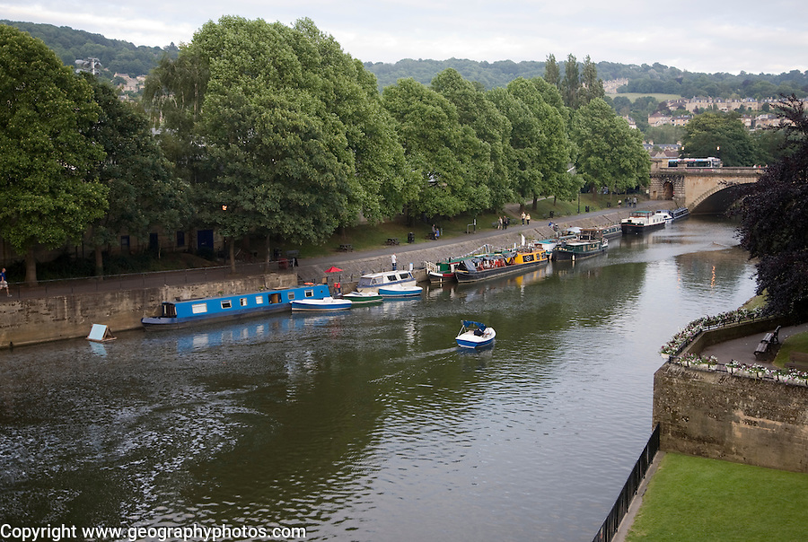 Boats at moorings on the River Avon, Bath, Somerset, England