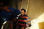 Sirte, LIBYA: Monday 11th October 2011:..A man suspected of being a Gaddafi loyalist soldier, center, questioned by rebel fighters. ...Ayman Oghanna