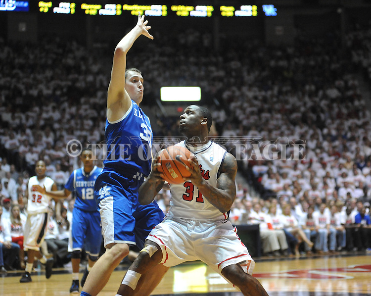 Ole Miss' Murphy Holloway (31) vs. Kentucky's Kyle Wiltjer (33) at the C.M. &quot;Tad&quot; Smith Coliseum on Tuesday, January 29, 2013. Kentucky won 87-74. (AP Photo/Oxford Eagle, Bruce Newman)..