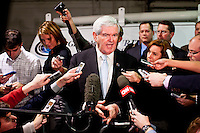 Republican presidential candidate Newt Gingrich speaks to reporters following a campaign meeting with employees of Global Security Services on Monday, December 19, 2011 in Davenport, IA.