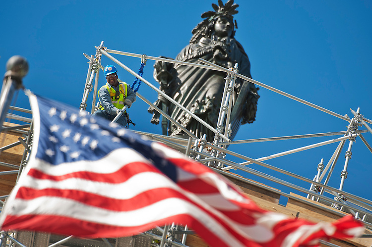 UNITED STATES - OCTOBER 20: Workers install scaffolding atop the Capitol dome as part of a restoration project, October 20, 2014. (Photo By Tom Williams/CQ Roll Call)