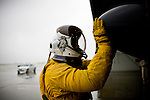 U2 pilot Major Eric Shontz touches the nose of his U2 before a &quot;high-flight&quot; at Beale Air Force Base February 24, 2010 in Linda, Calif.