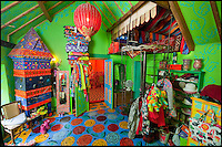 BNPS.co.uk (01202 558833)<br /> Pic: PhilYeomans/BNPS<br /> <br /> Dressing room.<br /> <br /> Britain's wackiest property has come on the market...And the estate agents mantra of paint everything magnolia has definately not been applied.<br /> <br /> It may look like an idyllic cottage in the Forest of Dean from the outside but ceramic artist Mary Rose Young's unique taste has transformed the interior into what looks like something from Alice in Wonderland.<br /> <br /> The three-bedroomed house is decorated from head to toe in crazy colours, clashing patterns, and enormous murals,<br /> each room is covered in the garish designs, including the bathroom, where even the sink and toilet have been adorned in bright tiles.<br /> <br /> Estate agents Bidmead Cook now have the tricky task of showing prospective punters round the &pound;500,000 property.
