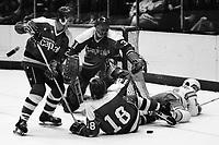 Seals vs Washington Capitols 1975.   Capitols Ron Lalone, Rick Bragnalo amd goalie Michel Belhumeu   Seal on ice John Stewart...photo/Ron Riesterer)