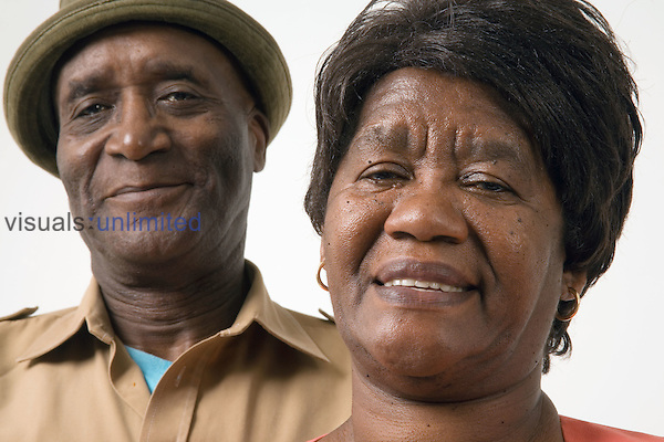 Portrait of an older couple smiling. MR