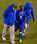 UK's Caleb Richardson is helped off the field after being tackled hard at midfield.