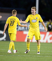 Robbie Rogers of the Crew celebrates with Chad Marshall of the Crew after Marshall scored a goal during the second half of the game against the Earthquakes at Buck Shaw Stadium in Santa Clara, California.  San Jose Earthquakes tied Columbus Crew, 2-2.