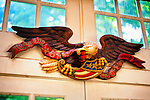 American Eagle, handcarved by Bob Y, with banner and flag on windowed wall, August 2012