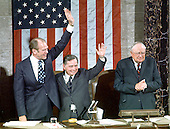United States Vice President  Gerald R. Ford, left, waves to his former colleagues following his being sworn-in by Chief Justice Warren Berger on December 6, 1973.  Speaker of the United States House of Representatives Carl Albert (Democrat of Oklahoma), center, and United States Senator James O. Eastland (Democrat of Mississippi), the President pro-tempore of the United States Senate, right, are on the rostrum with Ford.<br /> Credit: Arnie Sachs - CNP