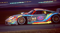 The #38  Porsche 911 GT1 Evo 005 of Andy Pilgrim, Ralf Kellners and Thierry Boutsen races through the darkness during the 24 Hours of Daytona, Daytona International Speedway, Daytona Beach, FL, February 1998.  (Photo by Brian Cleary/www.bcpix.com)