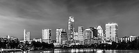 We captured this black and white panorama skyline of the city of Austin at night from along the Ladybird Lake hike and bike trail.   We thought the skyline with the high rise building were brilliant against the night sky with the Frost, Austonian, Four Season Hotel, Austin 360 and the W along with many others all crowding together along the shoreline.   You can see the reflection of the skyline in Ladybird lake but come back in a year or two and it will likely be different. The city skyline has been changing very fast over the last four or five years as new construction is popping up with high rise buildings almost every six or seven months in this town.