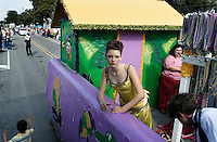 The Montegut, Louisiana High School homecoming float passes the visitors' stand during the annual Mardi Gras Parade.