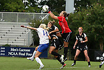 18 September 2011: Duke's Tara Campbell (in red) punches the ball away from teammate Erin Koballa (14) and Florida State's Janice Cayman (BEL) (2nd from left) and Tori Huster (10). The Duke University Blue Devils defeated the Florida State University Seminoles 2-1 at Koskinen Stadium in Durham, North Carolina in an NCAA Division I Women's Soccer game.
