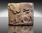 Picture & Image of  Neo-Hittite orthostat describing the legend of Gilgamesh from Karkamis,, Turkey. Ancora Archaeological Museum. To the left a bearded deity with a horned helmet is holding a lions back leg and is about to strike it with an axe. To the right a man is stabbing the lion with a dagger.