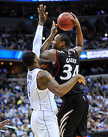 Yancy Gates of the Bearcats shoots a jump hook over Huskies' Alex Oriakhi. UConn defeats Cincinnati 69-58 during the 3rd round of the NCAA Tournament at the Verizon Center in Washington, D.C on Saturday, March 19, 2011. Alan P. Santos/DC Sports Box