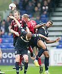 Ross County v St Johnstone...10.08.14  SPFL<br /> Centre halves do battle...Frazer Wright and Steven Anderson up against Scott Boyd and Jim Fenlon<br /> Picture by Graeme Hart.<br /> Copyright Perthshire Picture Agency<br /> Tel: 01738 623350  Mobile: 07990 594431