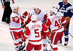 21 November 2009: The Detroit Red Wings celebrate a goal against the Montreal Canadiens at the Bell Centre in Montreal, Quebec, Canada. The Canadiens, wearing their original season 1909-10 throwback uniforms fell to the visiting Red Wings in a 3-2 shootout. Mandatory Credit: Ed Wolfstein Photo