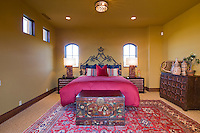 Colorful upstair guest bedroom with cerise-red bedding