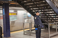 An NYPD officer is seen in the Times Square station in New York on Wednesday, March 2, 2016. The NYPD announced an effort to combat a spike in crimes, particularly slashings, in the subway by having more officers on trains and platforms. An officer will be on every train from 8 PM to 4 AM, a plan that was used years ago. Crime in the subway is up 25% compared to last year. (© Richard B. Levine)