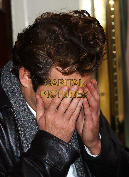 LUKE PERRY  .When Harry Met Sally photocall, Theatre Royal, Haymarket.8 January 2004.funny, hands in face.www.capitalpictures.com.sales@capitalpictures.com.©Capital Pictures