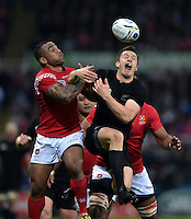 Fetu'u Vainikolo of Tonga competes with Ben Smith of New Zealand for the ball in the air. Rugby World Cup Pool C match between New Zealand and Tonga on October 9, 2015 at St James' Park in Newcastle, England. Photo by: Patrick Khachfe / Onside Images