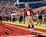 FSU running back Devonta Freeman puts a finger up to hush the 80,000 plus fans after scoring the third touchdown in the first quarter as the Florida State Seminoles defeated the North Carolina State Wolfpack 49-17 in their NCAA football game  in Tallahassee, Florida.