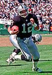 Oakland Raiders vs. Denver Broncos at Oakland Alameda County Coliseum Sunday, September 17, 2000.  Broncos beat Raiders  33-24.  Oakland Raiders quarterback Rich Gannon (12).