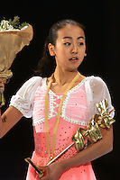 November 19, 2005; Paris, France; Figure skating star MAO ASADA of Japan celebrates gold medal win in ladies figure skating at Trophee Eric Bompard, ISU Paris Grand Prix competition.  Asada is just 15 years old and not eligible for the Torino 2006 Olympics, yet still a bright hope in Japanese figure skating for championships.<br />
