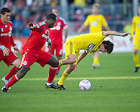16 October 2010: Toronto FC defender Nana Attakora #3 battles with Columbus Crew midfielder/forward Guillermo Barros Schelotto #7 during a game between the Columbus Crew and Toronto FC at BMO Field in Toronto..The game ended in a 2-2 draw.