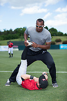 Kannapolis Intimidators conditioning coach Goldy Simmons helps outfielder Tyler Sullivan (2) stretch prior to the game against the Asheville Tourists at Kannapolis Intimidators Stadium on May 7, 2017 in Kannapolis, North Carolina.  The Tourists defeated the Intimidators 4-1.  (Brian Westerholt/Four Seam Images)