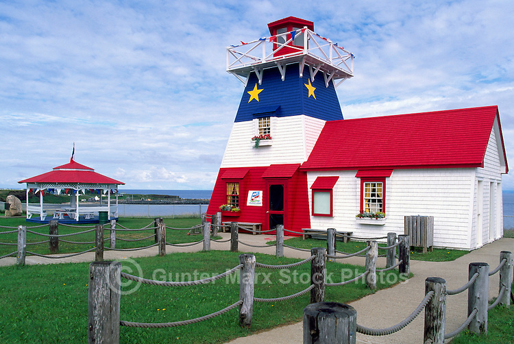 Grande-Anse, NB, New Brunswick, Canada - Replica Lighthouse / Tourist Information Centre, painted Blue, White, and Red / Bleu, Blanc, Rouge (Acadian National Flag Colours), along Route 11