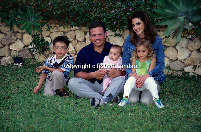 King Abdullah II and family pose for a photo in the garden of  the summer pallace in Aqaba, Jordan