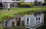 Mason Lewis attempts to catch a bass out of his family's pond on Friday, Oct. 11, 2013. Mason's father has been trying to get him into fishing and hunting to pull him away from the tv and his Xbox. <br /> Photo by Coty Giannelli