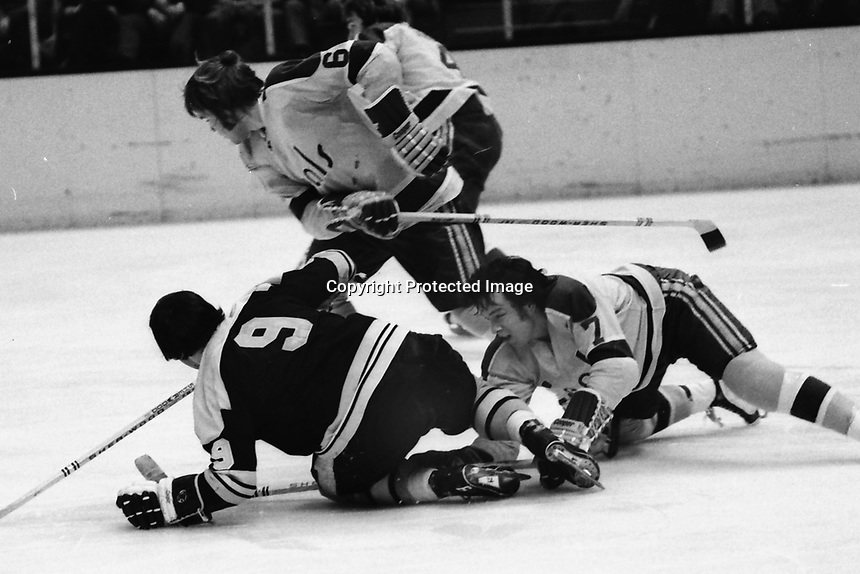Seals vs Boston: 1973 Seals Reggie Leach and Bob Stewart battle Bruins John Bucyk. (photo by Ron Riesterer)